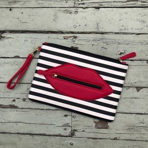 Betsey Johnson clutch with stripes and lips
